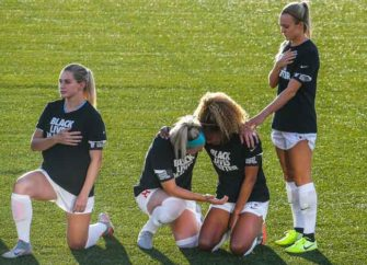 NWSL Soccer Players Take A Knee During National Anthem In Support Of The 'Black Lives Matter' Movement