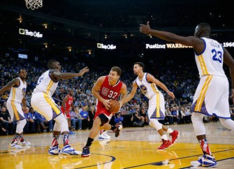 Blake Griffin Suffers Blocked Dunk Attempt by Festus Ezeli