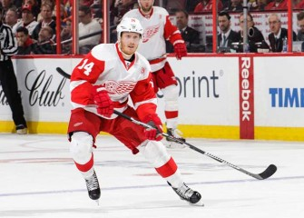 Watch: Red Wings' Gustav Nyquist Lands Vicious High-Stick To Face On Wilds' Jared Spurgeon