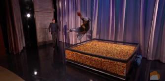 Marshawn Lynch Jumps Into Tank Of Skittles On 'Conan'