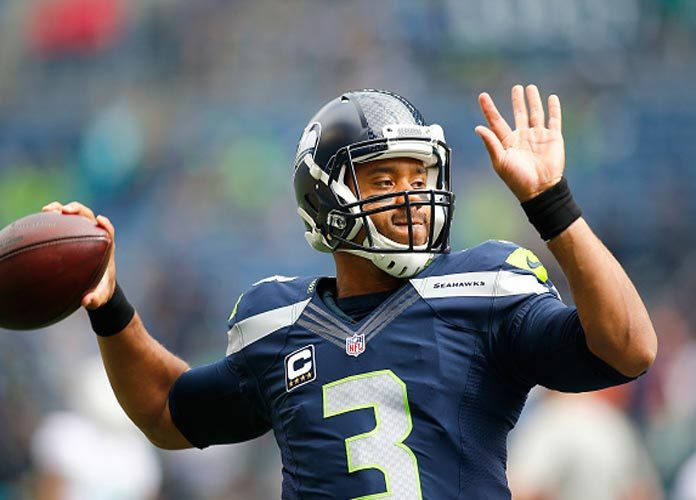 Russell Wilson Rewards Each Of His Offensive Linemen A $12,000 Amazon Stock Investment